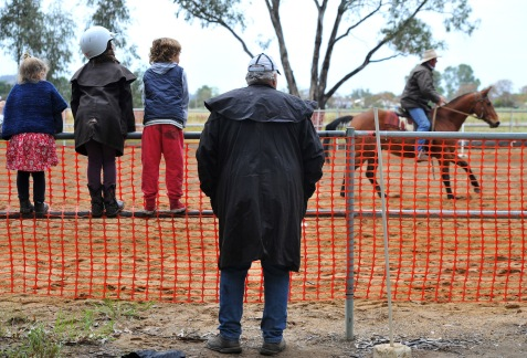 A family watching the local Gymkhana action.