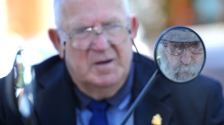 War veteran Brian Holden shares a moment of understanding with Bill Higgins during a Remembrance Day ceremony.