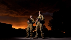 Army recruits standing by as the sun sets before a storm. 2013.